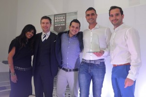 Il Forno team with Operations Director Theo Tsiolas accepting award from Nisha Katona at 2014 Food & Drink Awards.